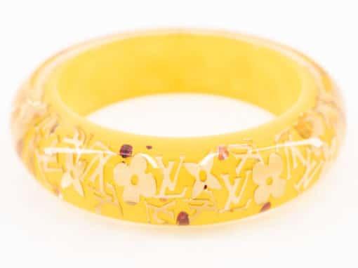 Bracelet Jonc Louis Vuitton Monogram Inclusion authentique d'occasion en résine jaune